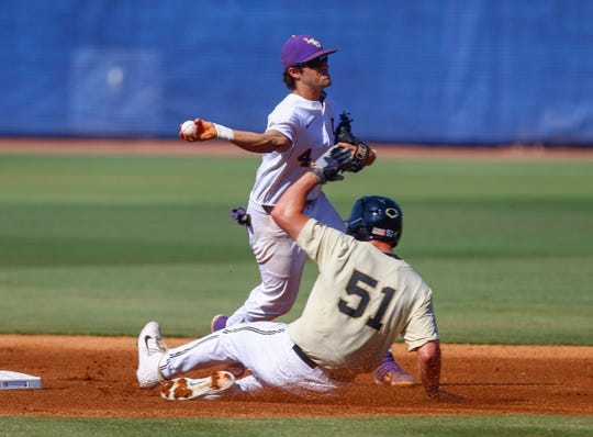 LSU shortstop Josh Smith (4) throws to first for the double play as Vanderbilt's JJ Bleday (51) slides into second base during the first inning of an NCAA college baseball game at the Southeastern Conference tournament, Saturday, May 25, 2019, in Hoover, Ala. (AP Photo/Butch Dill)