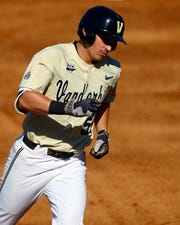 Vanderbilt's JJ Bleday rounds the bases after a solo home run during the third inning of the Southeastern Conference tournament NCAA college baseball game against LSU, Saturday, May 25, 2019, in Hoover, Ala. (AP Photo/Butch Dill)