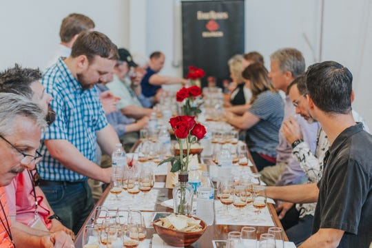 Kentucky Bourbon Affair guests make their selections at one of the Four Roses private barrel picks