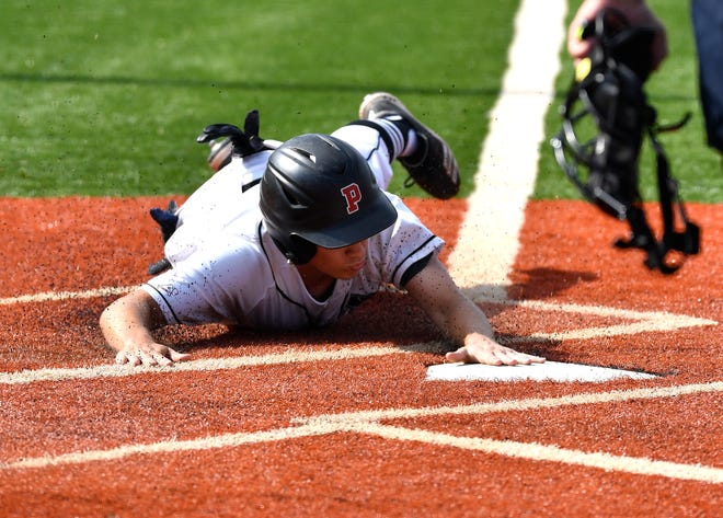 Pleasure Ridge Park's Cooper Haycraft slides across home plate to score during the Sixth Region championship game against Bullitt East at Eastern High School on Tuesday, May 28, 2019.