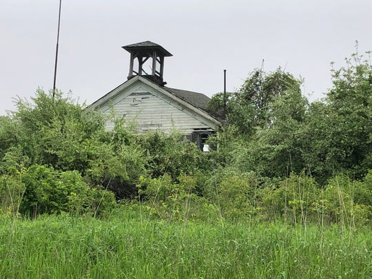 Merle Beach School has stood on South DeWitt Road in St. Johns for 154 years. Brush and vegetation nearly hides the one-room schoolhouse from passing traffic. Now the piece of Clinton County history is for sale.