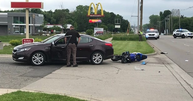 Police were investigating a crash involving a sedan and a motorcycle on Jolly Road, west of Dunckel Road.