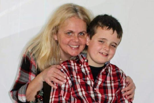 Julie A. Wood, 50, and Mason S. Lesczykowski, 10, are seen in a family photo. The Wisconsin Department of Justice said Tuesday that Wood and Mason, along with Jack G. Schigur, 69, were found dead Sunday inside a Kiel home.