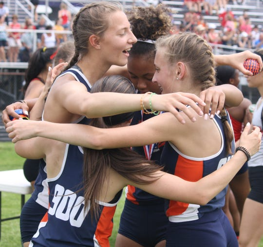 The Galion girls 4x100 relay team celebrates its regional title at Lexington High School.