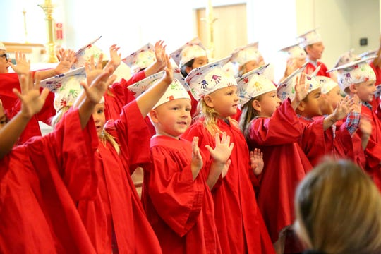 The new pre-K graduates perform.
