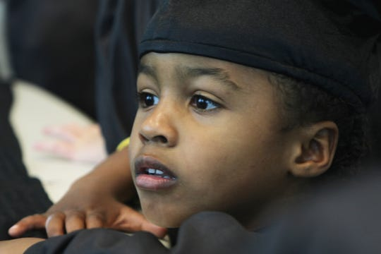 Jaime David is pensive before the graduation ceremony begins.
