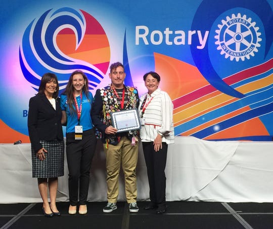 """Rotary District 6960 Governor Sandra Hemstead, Marco Island Academy Interact Club Representative Emily """"MJ"""" Boxma, Rotary Exchange Student (from Brazil) Guilherme Kach Das Cas, and Noontime Rotary Club President Pat Rutledge."""