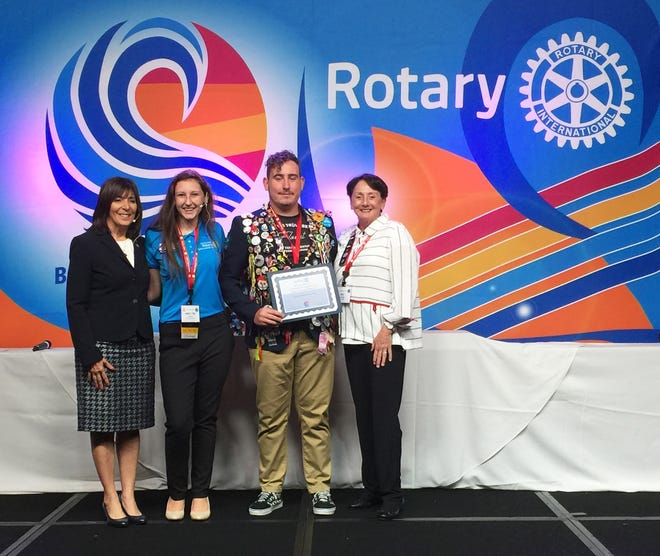 "Rotary District 6960 Governor Sandra Hemstead, Marco Island Academy Interact Club Representative Emily ""MJ"" Boxma, Rotary Exchange Student (from Brazil) Guilherme Kach Das Cas, and Noontime Rotary Club President Pat Rutledge."