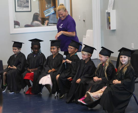 Pre-K teacher/director Kelly O'Connor takes the mic around asking each graduate to state their plans for the future.