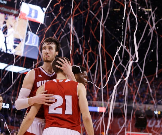 Wisconsin Badgers forward Frank Kaminsky hugs teammate Wisconsin Badgers guard Josh Gasser after a 68-63 loss to Duke during the  NCAA Men's Basketball Championship game at  Lucas Oil Stadium in Indianapolis, Indiana, Monday, April 6, 2015.