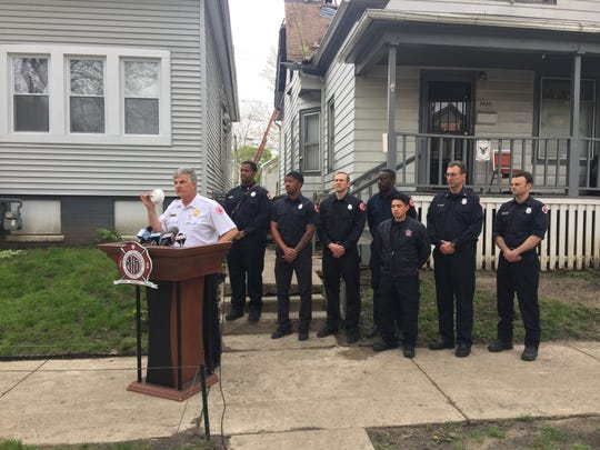 Fire Chief Mark Rohlfing speaks in a Milwaukee neighborhood after a fire killed on person. Firefighters canvased the area to make sure residents had working smoke detectors.