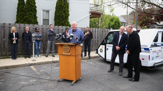 Mayor Tom Barrett speaks as two new 100% electric Milwaukee parking enforcement vehicles were introduced in Milwaukee.