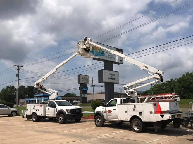 Workers mount a new sign as the Mountain Home Chamber of Commerce's new location at 1337 U.S. Highway 62 W. in Mountain Home.