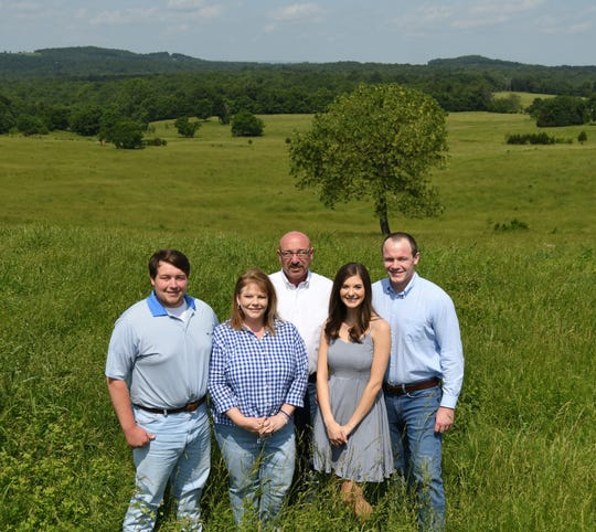 The Henderson family stands in a field on their farm on Shipp's Ferry Road. The Henderson have been recognized as Baxter County's 2019 Farm Family of the Year.