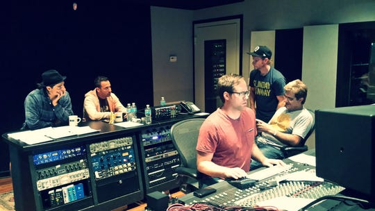 Montgomery native mixing engineer Chris Bethea works in the studio with Gary Baker and Backstreet Boys members Kevin Richardson, Howie Dorough, and Brian Littrell.