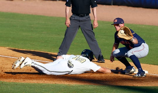 Vanderbilt's Stephen Scott (19) beats the throw to Auburn first baseman Rankin Woley (4) as he dives back to first during the third inning of a Southeastern Conference tournament NCAA college baseball game Wednesday, May 22, 2019, in Hoover, Ala. (AP Photo/Butch Dill)