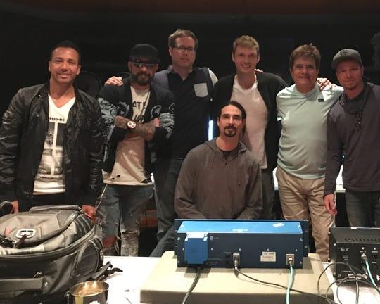 Montgomery native mixing engineer Chris Bethea, third from left, and grammy-winning producer and songwriter Gary Baker, second from right, with the Backstreet Boys.