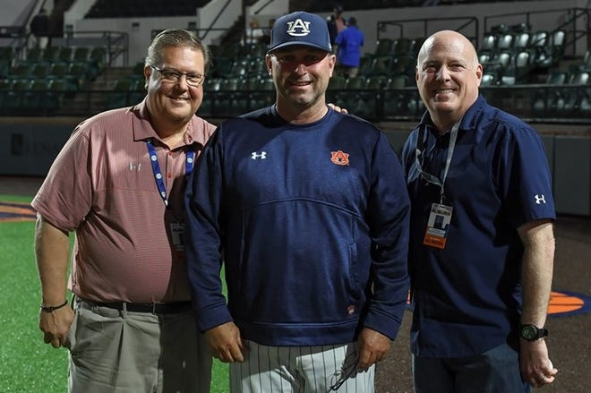 Auburn coach Butch Thompson (center) is photographed with Andy Burcham (left) and Rod Bramblett (right) on May 4, 2019.