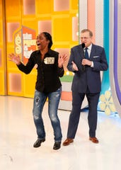 "Montgomery resident Sandra H. Glenn jumps on stage with ""The Price Is Right"" host Drew Carey. In all, she won more than $40,000 on the show, including her dream car - a Mini Cooper."