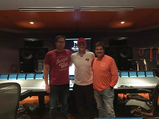 Montgomery native mixing engineer Chris Bethea, left, and grammy-winning producer and songwriter Gary Baker, right, of Noiseblock studio in Florence, Ala., with Backstreet Boys member Nick Carter.