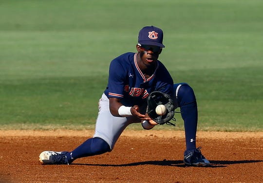 Auburn second baseman Ryan Bliss fields a grounder from Vanderbilt's Phillip Clarke during the first inning of a Southeastern Conference tournament NCAA college baseball game Wednesday, May 22, 2019, in Hoover, Ala. (AP Photo/Butch Dill)