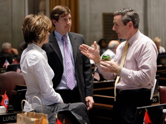 Rep. Glen Casada, R-Franklin, right, talks with Rep. Terri Lynn Weaver, R-Lancaster, left, and Rep. Brian Kelsey, R-Germantown, center, during a session of the House of Representatives in Nashville, Tenn., Wednesday, June 17, 2009.