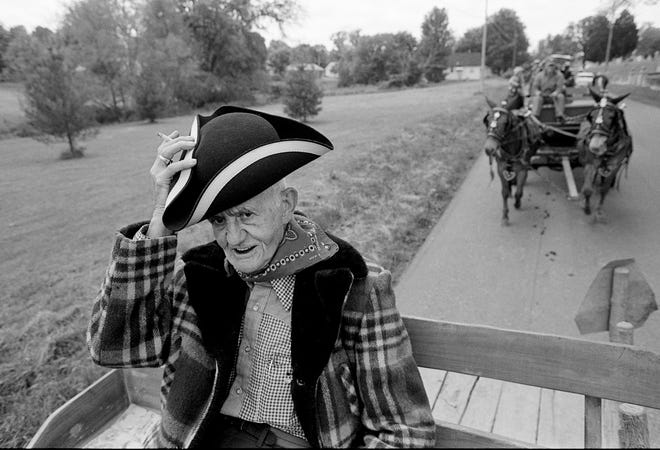 Gene Roberts, 86, tips his hat during the parade of the 30th annual Old Timer's Day in Dickson, Tenn. May 6, 1989. The parade includes numerous horse drawn entries each year.
