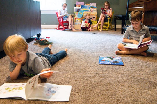 Lucas, 5, Sammie, 7, Matthew, 3, Becca, 9, and Thomas Peppers, 5, from left, read books at their Franklin home Thursday, May 23, 2019.