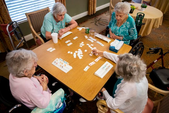 From left to right, Annette Malefyt, Katherine Dixon, Doris Flaitz, and Catherine Allen play Rummikub at Life Care Center of Estero on Wednesday, May 22, 2019.