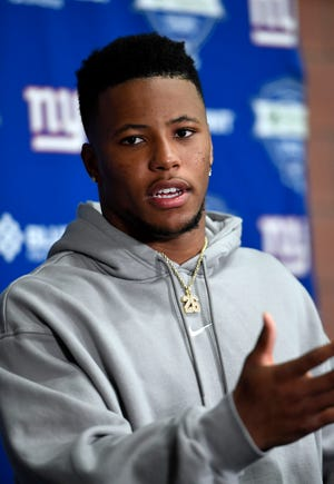 New York Giants running back Saquon Barkley talks to the media after the fourth day of OTAs on Tuesday, May 28, 2019, in East Rutherford.