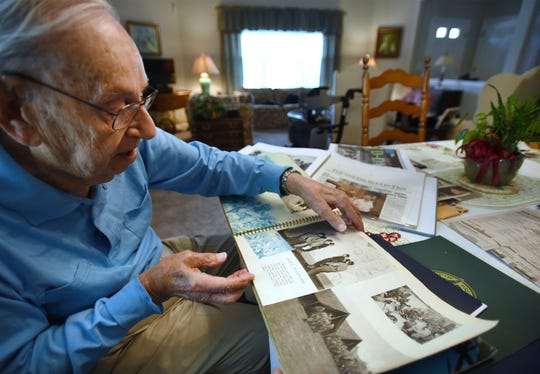 Daniel A. Passarella (age 96) of Brick, former member of the 101st Airborne Division, who went ashore on a landing craft at Normandy Beach on 6/6/44, shows historical photos during an interview at his home in Brick on 05/21/19.