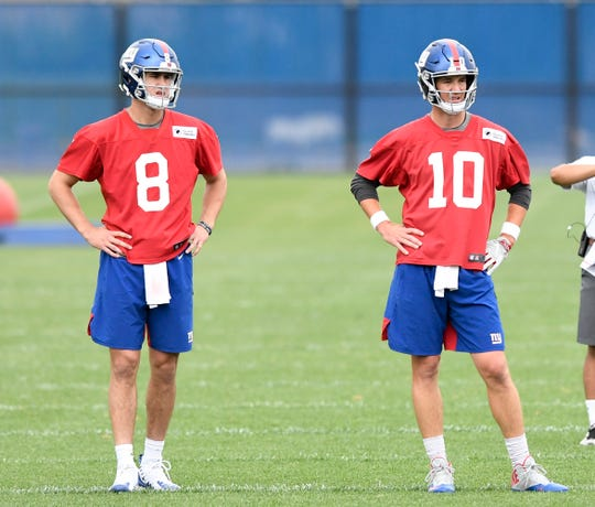 New York Giants rookie quarterback Daniel Jones (8) and starting quarterback Eli Manning (10) on the fourth day of OTAs on Tuesday, May 28, 2019, in East Rutherford.