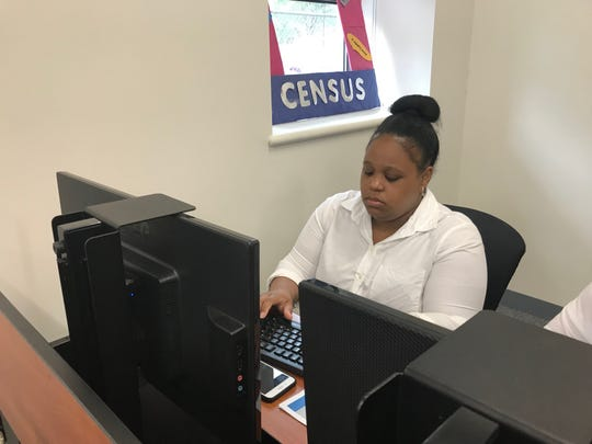 Chyres Carroll, 30, of Paterson applies for a temporary job with the U.S. Census Bureau at a job fair held on May 28, 2019 at Passaic County Community College.