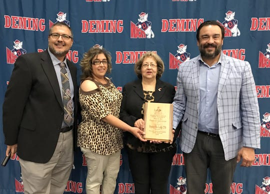 Deming Elks Lodge 2750 received the Friend of Wildcat Sports Award during the second annual Deming High School All-Sports Banquet held on May 21. From left are DHS Athletic/Activities Director Bernie Chavez, Elks Lecturing Knights Yvonne Jasso Perales, Elks Exalted Ruler Anna Jean Armijo and Deming Public Schools Superintendent Dr. Arsenio Romero.