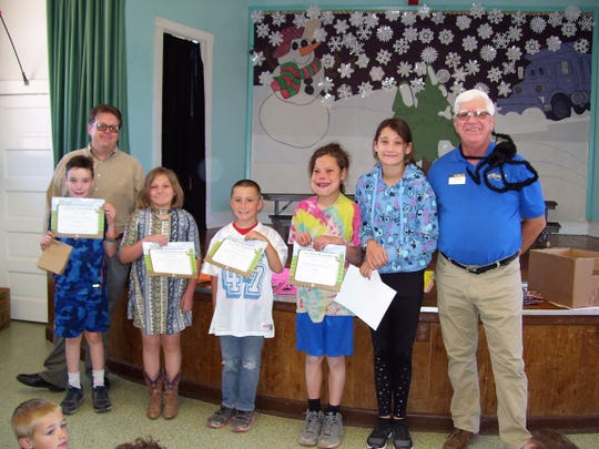 High Rolls/ Mountain Park Principal Ryal McMurry and Ned Kline of Alamogordo Kiwanis Club with five of High Rolls/Mountain Park Elementary's 31 BUG Honor Roll students.