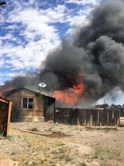 A grass fire burned down the Webber home in Alamogordo May 6.