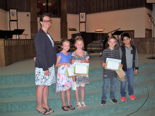 Imago dei Academy Principal Laura King with four of Imago dei Academy's 11 BUG Honor Roll students.