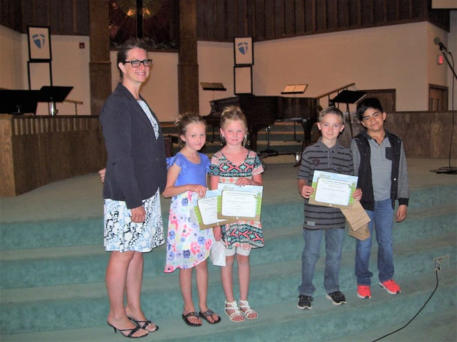 Imago dei Academy Principal Laura King with four of Imago dei Academy's 11 BUG Honor Roll students.