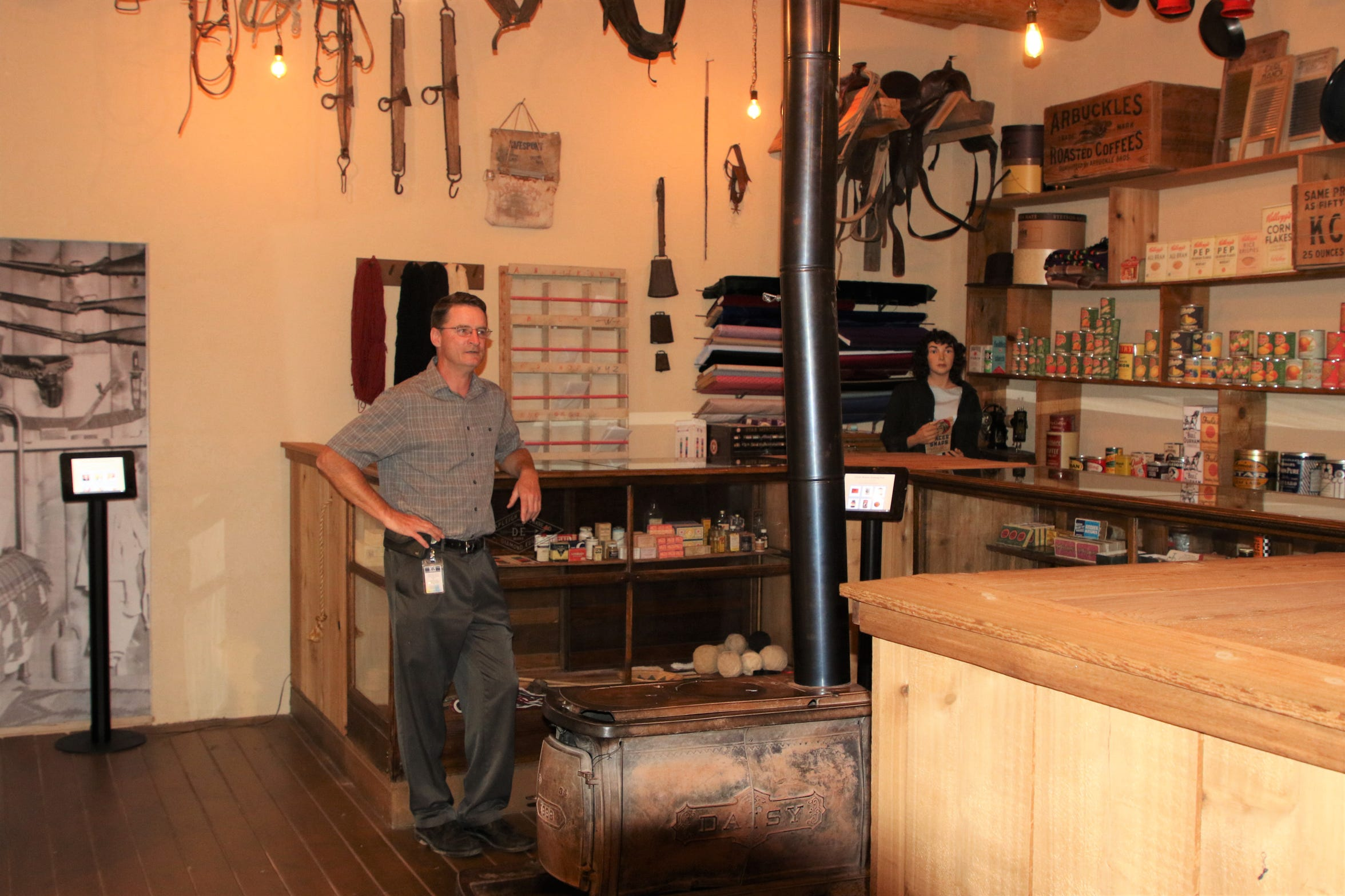 Farmington Museum director Bart Wilsey stands at the counter of a replica trading post that is a popular exhibit at his museum.