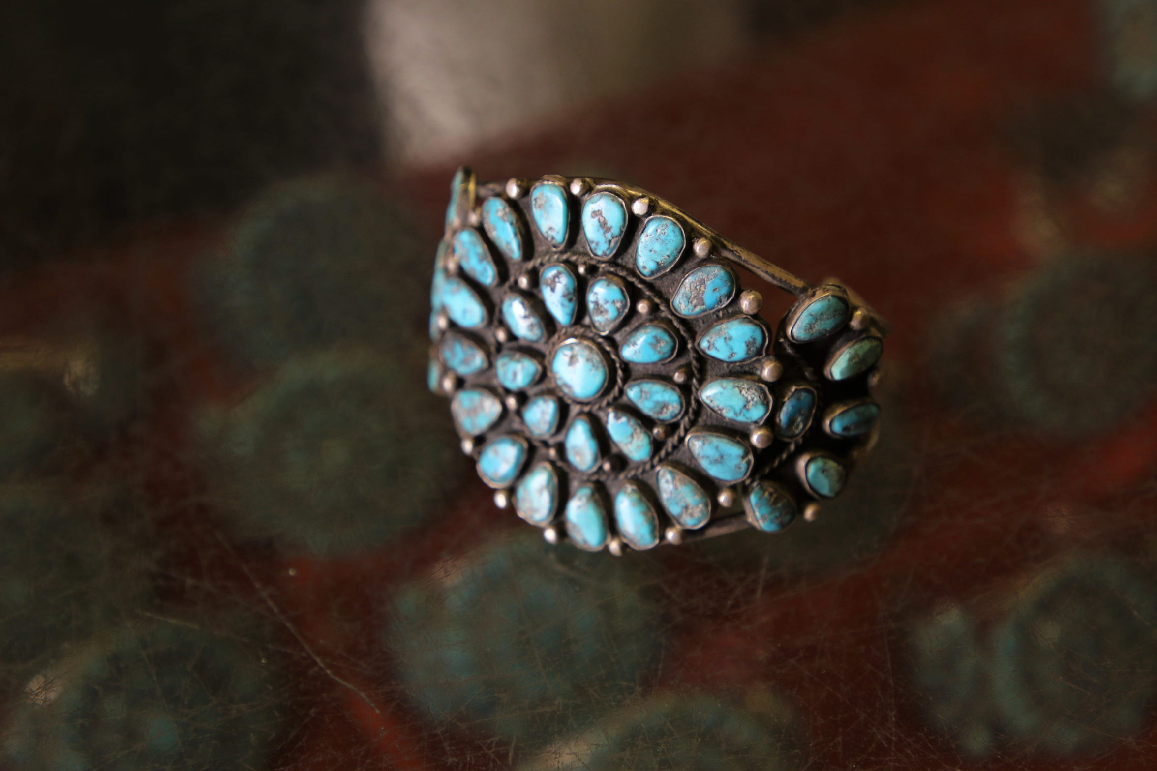 A vintage turquoise bracelet is displayed at the Hatch Brothers Trading Post in Fruitland.
