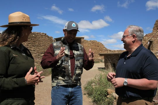 At center, U.S. Sen. Martin Heinrich, D-NM, tells park superintendent Denise Roberts and Interior Secretary David Bernhardt about his experience with masonry, Tuesday, May 28, 2019, during a tour of Pueblo Bonito at Chaco Culture National Historical Park.