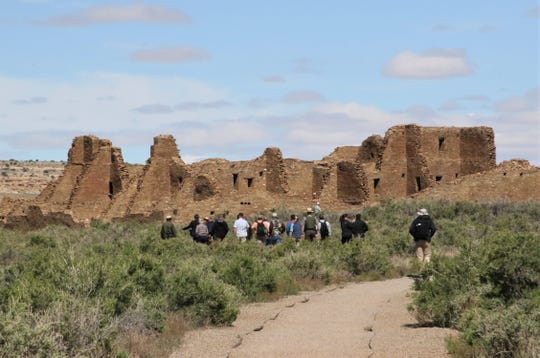 A group including Interior Secretary David Bernhardt and U.S. Sen. Martin Heinrich, D-NM, walk, Monday, May 28, 2019, toward Pueblo Bonito at Chaco Culture National Historical Park.