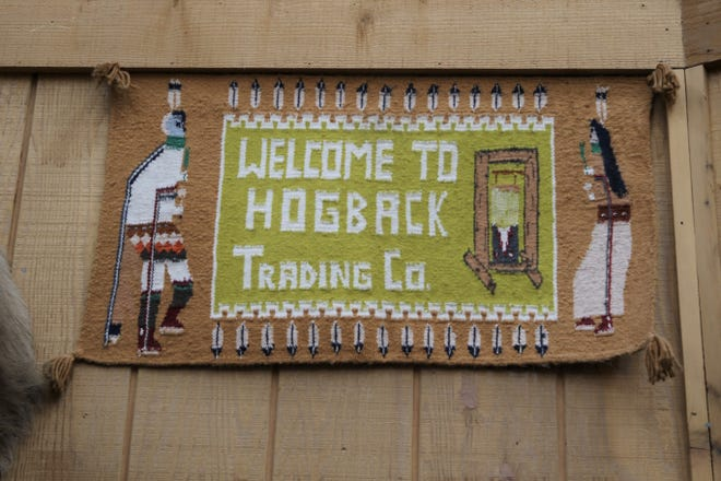 A woven sign greets visitors to the Hogback Trading Co. in Waterflow.