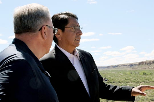 Navajo Nation President Jonathan Nez and Interior Secretary David Bernhardt look out over Pueblo Bonito, Tuesday, May 28, 2019, at Chaco Culture National Historical Park.