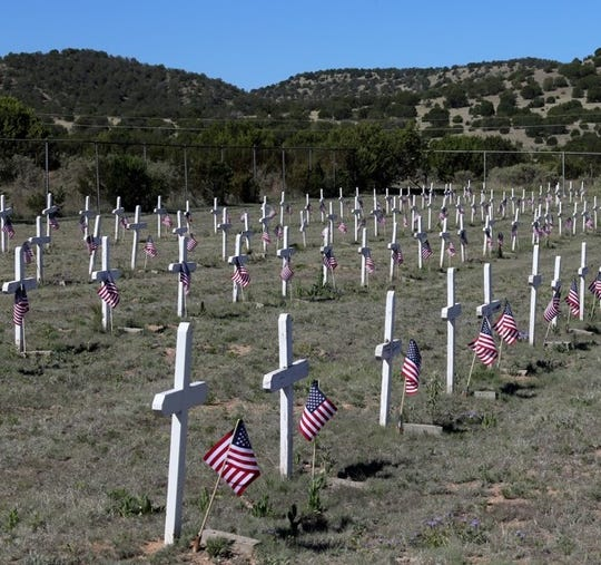 Flags were placed by Spencer Theater ushers and other volunteers on the graves at Fort Stanton Military and Merchant Marine Cemetery.