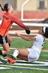 Stevenson Spartan goalie Haley Demers collides with Farmington forward Kristina Agee as Agee gets near the Spartan net with the soccer ball in the first half.