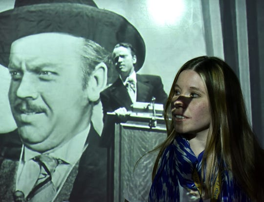 "South Lyon High teacher Brittany Smithkort plans to incorporate classic films, like Orson Welles' ""Citizen Kane,"" into her curriculum next year in a class called Film and Lit. She'll be showing Welles' film (she stands in front of a projection of a scene from the film) and several others."