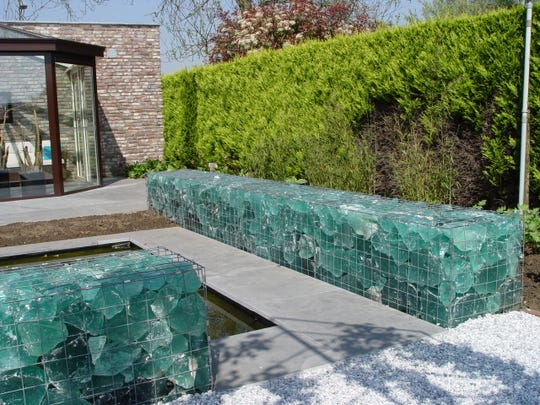 This gabion is filled with recycled slag glass fragments for a beautiful effect day and night when backlit.