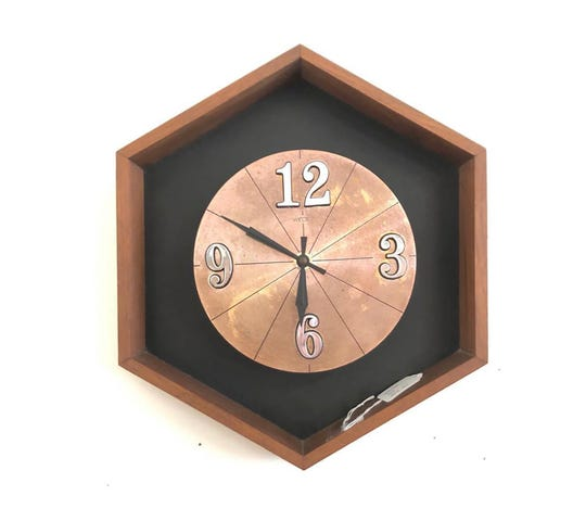 Vintage wood and metal wall clock from the 1970s