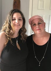 Kayleigh Simpson, left, poses for a picture with her grandmother, Cheryl Cardwell, right. Cheryl was diagnosed with Stage IV lung cancer in October and vowed to live long enough to see Kayleigh graduate, which she did on Saturday.